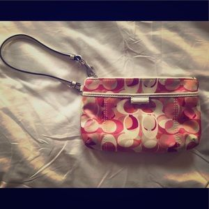 Never been used genuine Coach wristlet purse